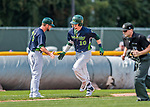4 September 2017: Vermont Lake Monsters outfielder Greg Deichmann is greeted by Manager Aaron Nieckula rounding third after hitting a solo home run to lead off the 3rd inning during the first game of a double-header against the Tri-City ValleyCats at Centennial Field in Burlington, Vermont. The Lake Monsters split their games, falling 6-5 in the first, then winning the second 7-4, thus clinching the NY Penn League Stedler Division Championship. Mandatory Credit: Ed Wolfstein Photo *** RAW (NEF) Image File Available ***