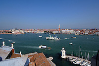 Venice and the busy waterways, showing assorted craft, and many famous landmarks.