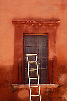 Wooden ladder leaning against an iron balcony, San Miguel de Allende, Mexico