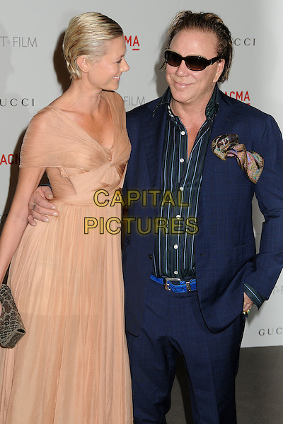 Anastassija Makarenko and Mickey Rourke.The Inaugural Art and Film Gala held at LACMA in Los Angeles, California, USA..November 5th, 2011.half 3/4 profile length beige dress couple stripe shirt blue sunglasses shades.CAP/ADM/BP.©Byron Purvis/AdMedia/Capital Pictures.