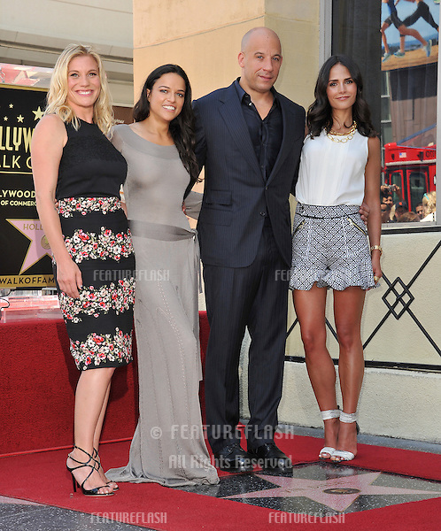 Vin Diesel with Katee Sakhoff (left), Michelle Rodriguez &amp; Jordana Brewster on Hollywood Blvd where he was honored with the 2,504th star on the Hollwood Walk of Fame.<br /> August 26, 2013  Los Angeles, CA<br /> Picture: Paul Smith / Featureflash