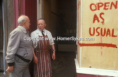 Toxteth Liverpool Lancashire 1981. The day after a night of rioting. Butchers shop still open.