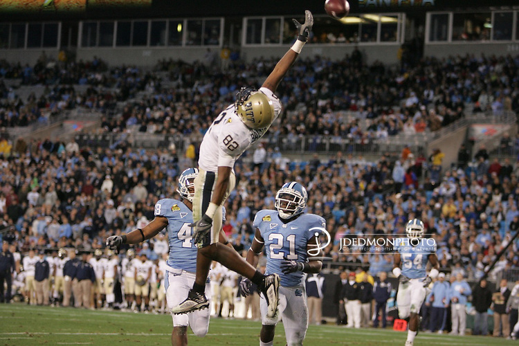202 27 December 2009: Meineke Car Care Bowl action at Bank of America Stadium Charlotte North Carolina as Pittsburgh wide receiver Jonathan Baldwin just misses a touchdown pass. Pitts leads UNC at the half 13-10..Mandatory Credit:Jim Dedmon/ Southcreek Global, Meineke Car Care Bowl 09