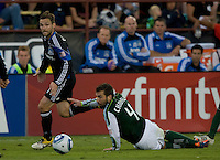 Bobby Convey of Earthquakes battles for the ball against Mike Chabala of Timbers during the game at Buck Shaw Stadium in Santa Clara, California on August 6th, 2011.   San Jose Earthquakes and Portland Timbers tied 1-1.