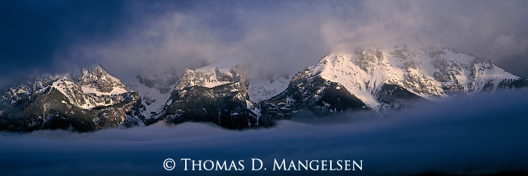Snow-capped  Tetons shrouded in storm clouds in Grand Teton National Park, Wyoming.