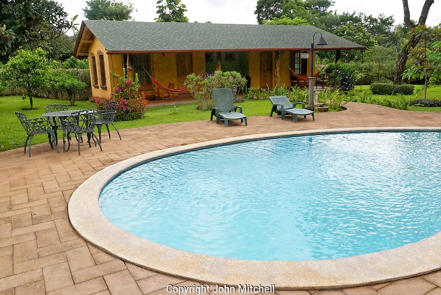 Swimming pool and guest cabins at Hotel Santa Leticia near Apaneca in western El Salvador, Central America