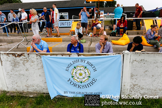 Yorkshire fans watching the game with a patriotic banner. Yorkshire v Parishes of Jersey, CONIFA Heritage Cup, Ingfield Stadium, Ossett. Yorkshire's first competitive game. The Yorkshire International Football Association was formed in 2017 and accepted by CONIFA in 2018. Their first competative fixture saw them host Parishes of Jersey in the Heritage Cup at Ingfield stadium in Ossett. Yorkshire won 1-0 with a 93 minute goal in front of 521 people. Photo by Paul Thompson