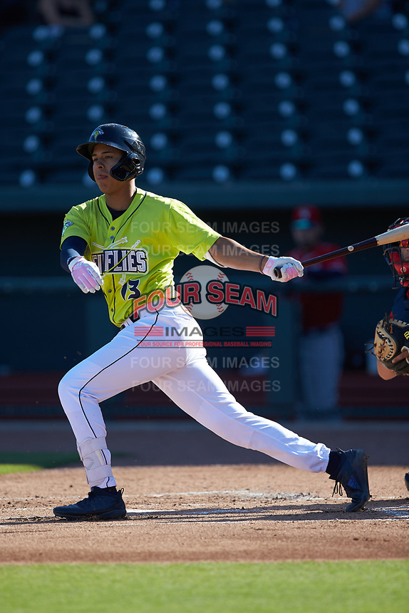 Mark Vientos (13) of the Columbia Fireflies follows through on his swing against the Rome Braves at Segra Park on May 13, 2019 in Columbia, South Carolina. The Fireflies walked-off the Braves 2-1 in game one of a doubleheader. (Brian Westerholt/Four Seam Images)