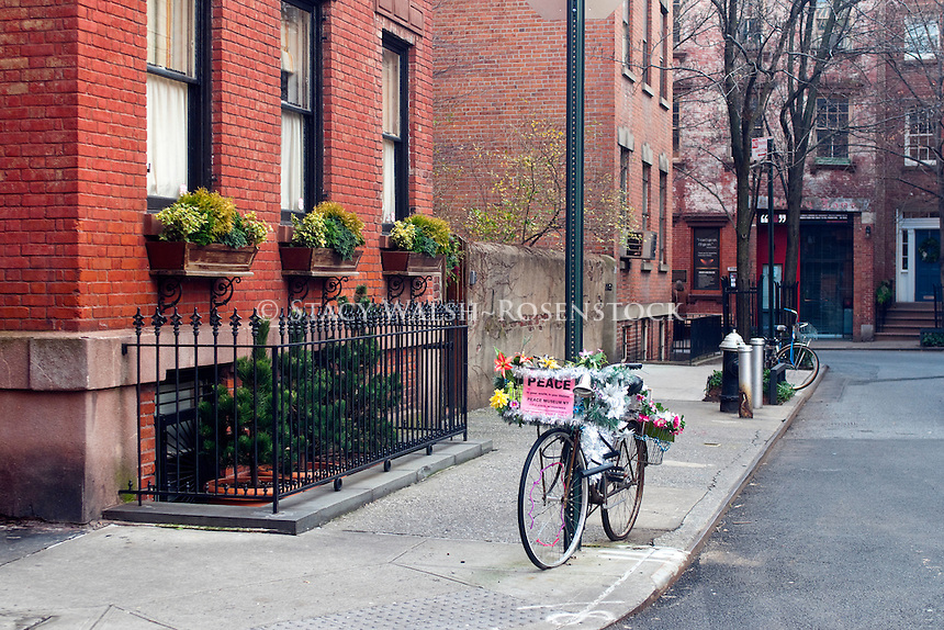 New York, NY -  23 December 2012 Bicycle with a Peace Museum flyer in the basket on Commerce Street in the West Village