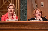 """United States Senator Elizabeth Warren (Democrat of Massachusetts), left, and US Senator Heidi Heitkamp (Democrat of North Dakota), right, listen as witnesses testify during the US Senate Committee on Banking, Housing and Urban Affairs hearing titled """"Implementation of the Economic Growth, Regulatory Relief, and Consumer Protection Act"""" on Capitol Hill in Washington, DC on Tuesday, October 2, 2018.<br /> Credit: Ron Sachs / CNP"""