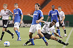 Oct 05 2007:  Nick Garcia (3) of the Wizards passes the ball before Christian Gomez (10) of D.C. United gets physical.  The MLS Kansas City Wizards tied the visiting D.C.United 1-1 at Arrowhead Stadium in Kansas City, Missouri, in a regular season league soccer match.