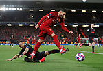 Alex Oxlade-Chamberlain of Liverpool tackled by Renan Lodi of Atletico Madrid during the UEFA Champions League match at Anfield, Liverpool. Picture date: 11th March 2020. Picture credit should read: Darren Staples/Sportimage