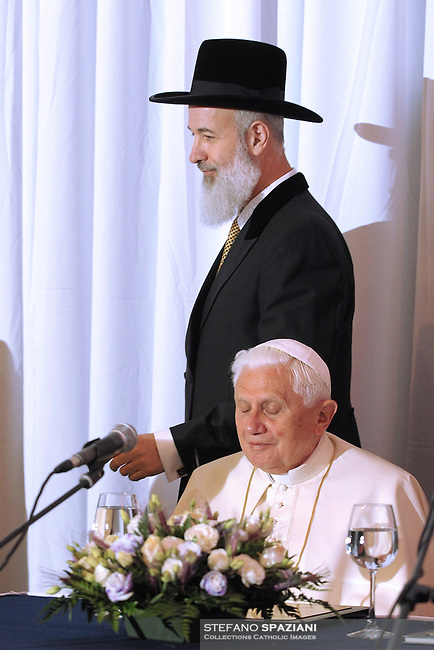 "Pope Benedict XVI, receives a gift from Israeli chief Rabbis Shlomo Amar, right, and Yona Metzger, left, at the center for the Jewish Heritage in Jerusalem, Tuesday, May 12, 2009. The pope told Israel's two chief rabbis that the Catholic Church is ""irrevocably committed"" to ""a genuine and lasting reconciliation between Christians and Jews"