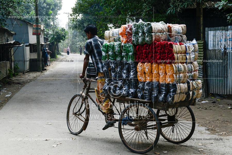 BANGLADESH, Tangail, transport of dyed cotton yarn by bicycle rikshaw / BANGLADESCH, Distrikt Tangail, Kalihati, Transport von gefaerbten Baumwollgarnen per Fahrradrikscha