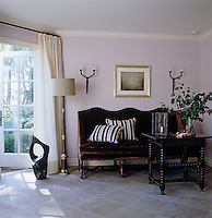 A 19th century French banquette has been used to furnish the poolhouse