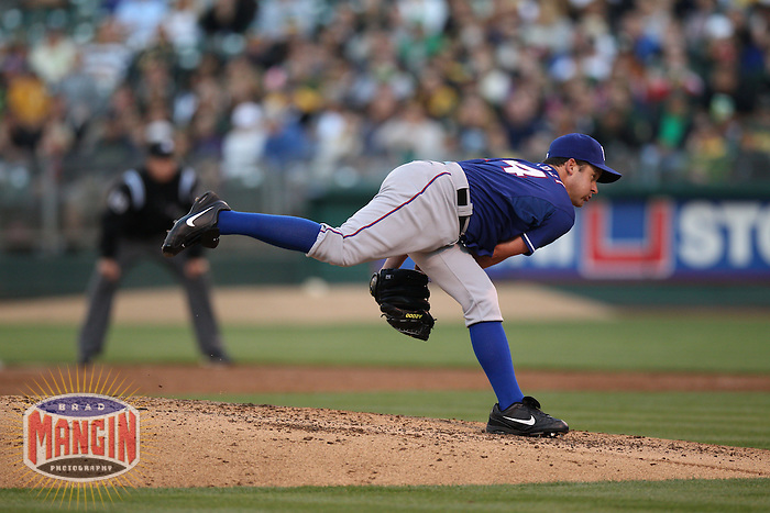 OAKLAND, CA - JULY 17:  Roy Oswalt #44 of the Texas Rangers pitches against the Oakland Athletics during the game at O.co Coliseum on Tuesday, July 17, 2012 in Oakland, California. Photo by Brad Mangin