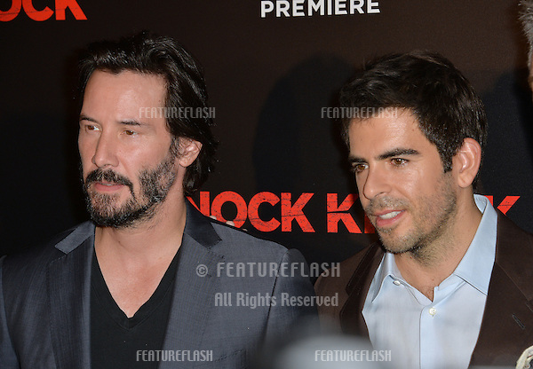 Keanu Reeves &amp; director Eli Roth (right) at the Los Angeles premiere of their movie &quot;Knock Knock&quot; at the TCL Chinese Theatre, Hollywood.<br /> October 7, 2015  Los Angeles, CA<br /> Picture: Paul Smith / Featureflash