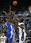 Air Force's Justin Hammonds shoots over Nevada defender Jerry Evans, Jr. during an NCAA basketball game in Reno, Nev., on Saturday, Feb. 1, 2014. Nevada won 69-56 in overtime. (AP Photo/Cathleen Allison)