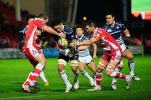 12.11.2013 Gloucester, England.Japan Flanker (#7) Justin Ives is tackled during the first half of the International Friendly Rugby Union match between Gloucester Rugby and Japan at Kingsholm Stadium.