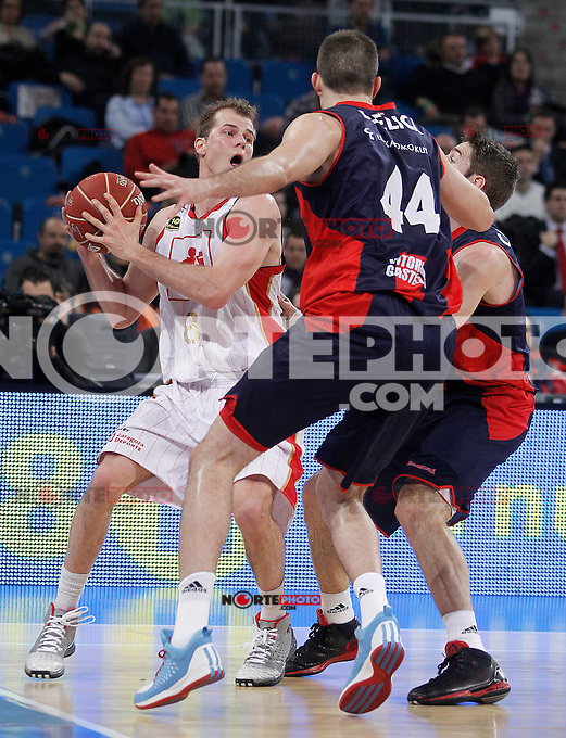 Caja Laboral Baskonia's Nemanja Bjelica (c) and Fabien Causeur (r) and CAI Zaragoza's Michael Roll during Spanish Basketball King's Cup match.February 07,2013. (ALTERPHOTOS/Acero)