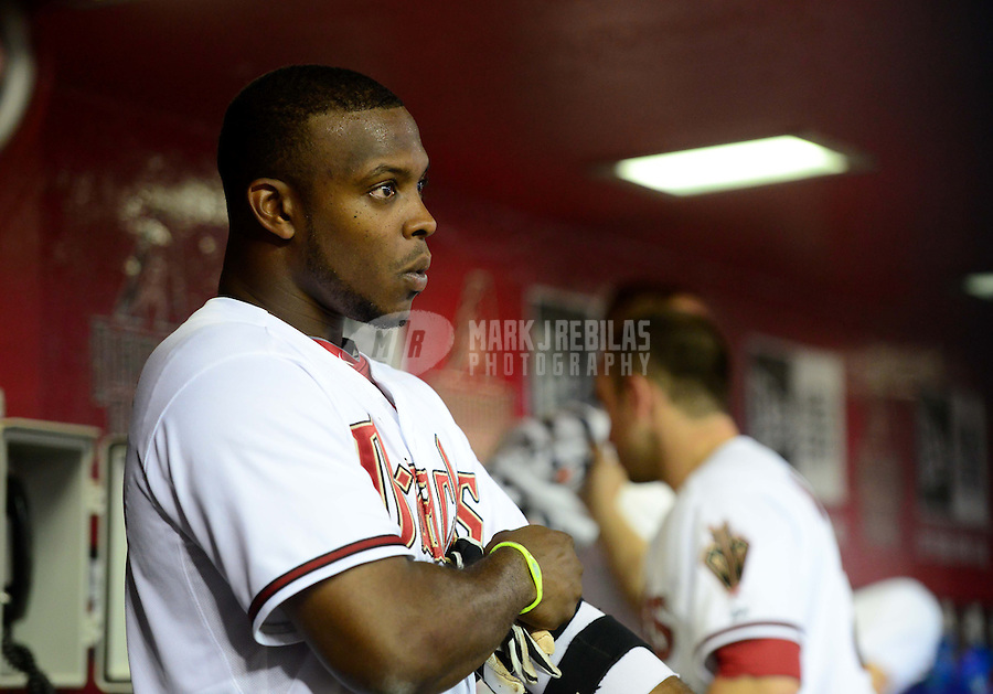 Jun. 8, 2012; Phoenix, AZ, USA; Arizona Diamondbacks outfielder Justin Upton in the dugout in the eighth inning against the Oakland Athletics at Chase Field.  Mandatory Credit: Mark J. Rebilas-