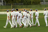 The PNBHS team walk out for the 2018 Junior NZ Secondary School Cricket Boys' Tournament match between St Andrew's College and Palmerston North Boys' High School at Fitzherbert Park in Palmerston North, New Zealand on Friday, 23 March 2018.. Photo: Dave Lintott / lintottphoto.co.nz