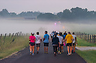 August 15, 2017;  Pilgrims start out at dawn to make the 39 mile trek, 18 walking and 21 biking on day 2 of the ND Trail from Oaktown to Pimento, Indiana. As part of the University's 175th anniversary celebration, the Notre Dame Trail will commemorate Father Sorin and the Holy Cross Brothers' journey. A small group of pilgrims will make the entire 300+ mile journey from Vincennes to Notre Dame over  two weeks. (Photo by Barbara Johnston/University of Notre Dame)