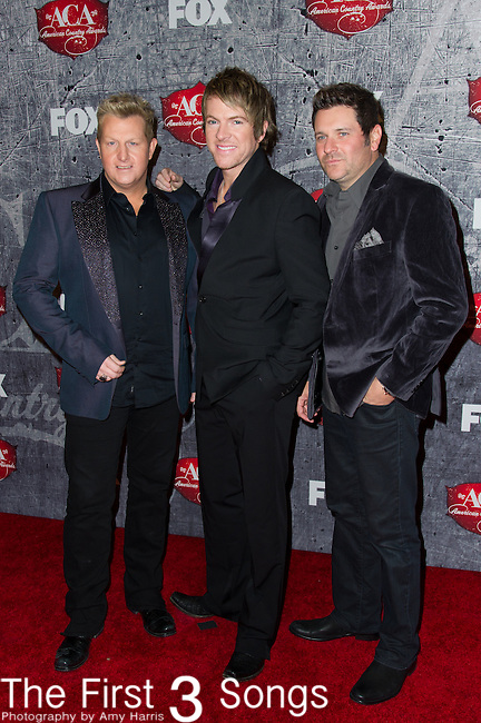 Gary LeVox, Joe Don Rooney, and Jay Demarcus of Rascal Flatts arrives at the American Country Awards 2012 at the Mandalay Bay Resort & Casion in Las Vegas, Nevada