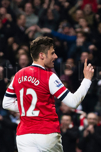25.03.2014  London, England.  Arsenal forward Olivier GIROUD celebrates scoring to make it 2-1 during the Premier League game between Arsenal and Swansea City from the Emirates Stadium