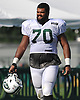 Dakota Dozier #70 heads off the field after a day of New York Jets Training Camp at Atlantic Health Jets Training Center in Florham Park, NJ on Tuesday, Aug. 1, 2017.