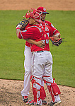 28 July 2013: Washington Nationals pitcher Fernando Abad gives catcher Wilson Ramos a hug after a game win over the New York Mets at Nationals Park in Washington, DC. The Nationals defeated the Mets 14-1. Mandatory Credit: Ed Wolfstein Photo *** RAW (NEF) Image File Available ***