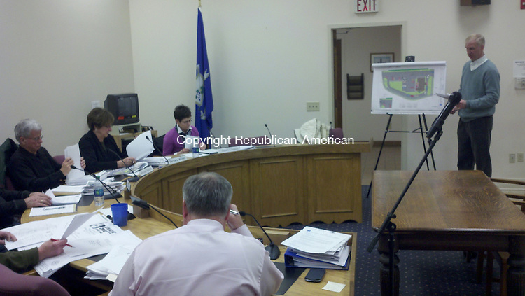 WINSTED - 10 Feb. 2014 - 021014KM01 - Engineer Todd Parsons presents a revised plan for a Dunkin' Donuts on the west end of downtown to the Winsted Planning and Zoning Commission Monday night. The commission approved the plan. Kurt Moffett Republican-American