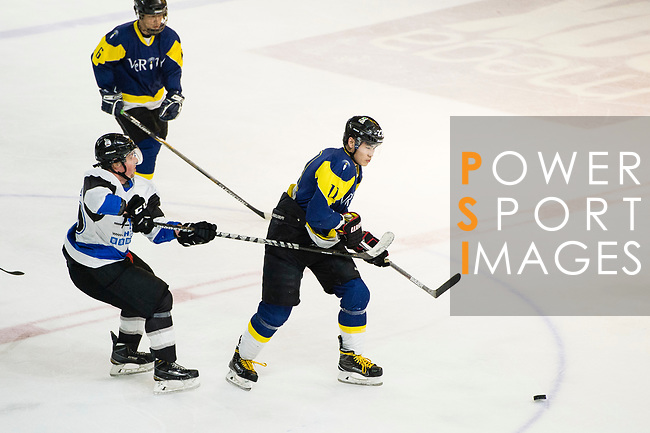 Verity Skater #11 Ryan Wong (right) fights for the puck with Gaggia Empire Defense #26 Jamie Stark (left) during the match Gaggia Empire vs Verity, a match part of the Principal Standard League on 07 March 2017 in Mega Ice, Hong Kong, China. Photo by Marcio Rodrigo Machado / Power Sport Images
