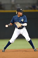 Shortstop Milton Ramos (24) of the Columbia Fireflies plays defense in a game against the Lexington Legends on Thursday, June 8, 2017, at Spirit Communications Park in Columbia, South Carolina. Columbia won, 8-0. (Tom Priddy/Four Seam Images)