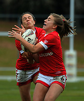Julianne Zussman (left) and Frederique Rajotte close in on a high ball during the 2017 International Women's Rugby Series rugby match between Canada and Australia Wallaroos at Smallbone Park in Rotorua, New Zealand on Saturday, 17 June 2017. Photo: Dave Lintott / lintottphoto.co.nz