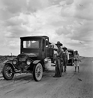 Hard Travelin': Drought refugees stopped along the highway near Lordsburg, New Mexico. May 1937.<br /> <br /> Photo by Dorothea Lange.