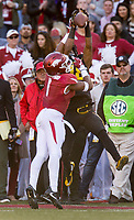 Hawgs Illustrated/BEN GOFF <br /> Dominic Collins, Missouri wide receiver, catches a pass under pressure from Chevin Calloway (1), Arkansas cornerback, in the second quarter Friday, Nov. 24, 2017, at Reynolds Razorback Stadium in Fayetteville.
