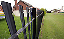 The current fencing of Hazelwood Integrated Primary School, marks the area where a new peaceline is due to be built inside the school grounds, keeping rival youths from the Whitewell Road area away from a small mixed housing estate of Old Throne Park. Photo/Paul McErlane.