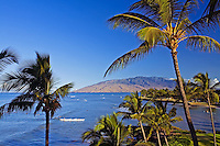 Cove Park is framed by palm trees in Kihei, Maui with the West Maui Mountains in the distance.