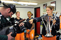 Yael Averbuch (13) of Sky Blue FC holds the WPS Championship Trophy in the locker room during a segment taped for Fox Soccer Channel. Sky Blue FC defeated the Chicago Red Stars 1-0 in a Women's Professional Soccer (WPS) match at Yurcak Field in Piscataway, NJ, on April 11, 2010.
