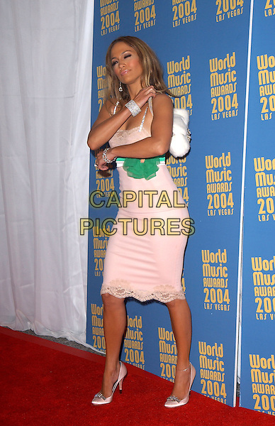 JENNIFER LOPEZ.15th Annual World Music Awards held at The Thomas & Mack Center in Las Vegas, Nevada .September 15,2004.full length, pink lace dress, green corsage belt, bag, bracelet.www.capitalpictures.com.sales@capitalpictures.com. Copyright 2004 by Debbie VanStory