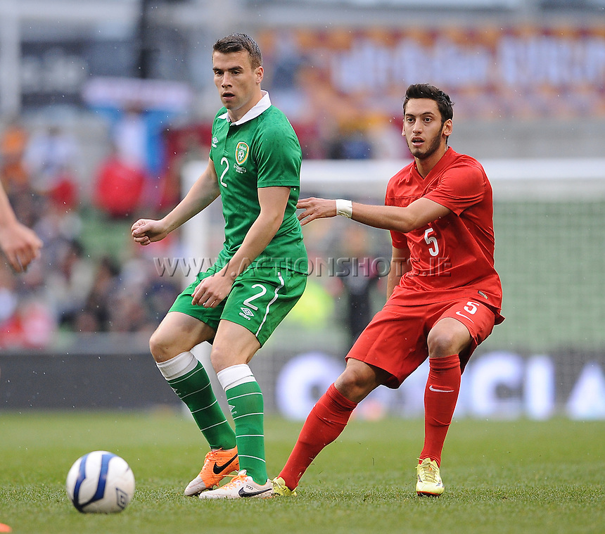 25h May 2014; International Friendly, Ireland's Seamus coleman and Hakan Calhanoglu. Republic of Ireland v Turkey, Aviva Stadium, Dublin. Picture credit: Tommy Grealy/actionshots.ie.