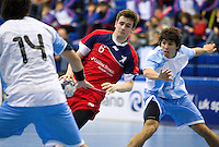 05 APR 2012 - LONDON, GBR - Great Britain's Ben Murray (GBR) (#6, in red and blue) looks for a way through the Argentinian defence during the men's 2012 London Cup match at the National Sports Centre in Crystal Palace, Great Britain .(PHOTO (C) 2012 NIGEL FARROW)