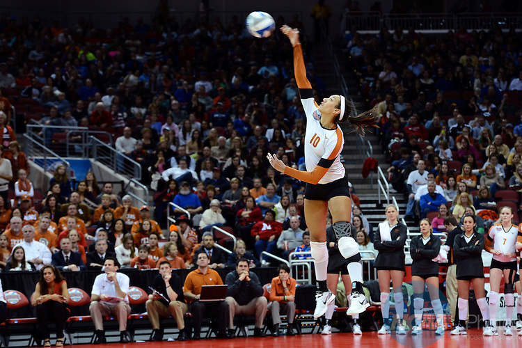 13 DEC 2012: Haley Eckerman (10) of Texas serves the ball during the Division I Woman's Volleyball Championship held at the KFC Yum Center in Louisville, KY. The University of Texas defeated Oregon 3-0 to claim the national title. Stephen Nowland/NCAA Photos