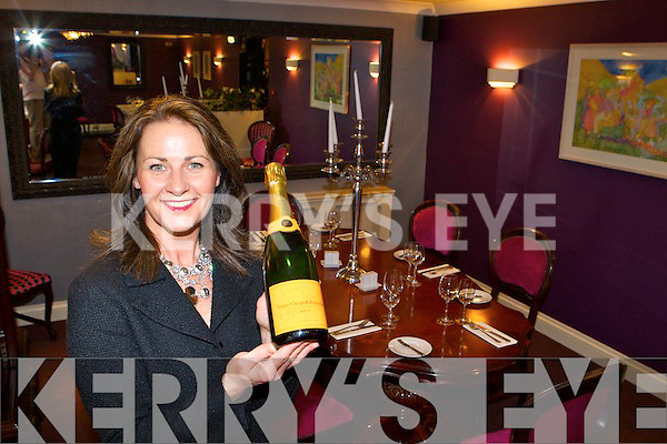 Mary Corkery with one of the many varieties of wine and champagne for a perfect compliment for your meal .