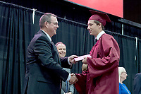 Bud Sullins/Special to the Herald-Leader<br /> Siloam Springs School Board member Brent Butler congratulates Sam Everett.