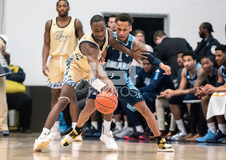 WASHINGTON, DC - FEBRUARY 8: Shawn Walker Jr. #1 of George Washington holds the ball away from Fatts Russell #1 of Rhode Island during a game between Rhode Island and George Washington at Charles E Smith Center on February 8, 2020 in Washington, DC.