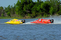 Frame 1: Terry Rinker (#10) and Chris Fairchild (#62) race up the back stright to turn 2 where Rinker's boat rolls over a wake, noses in and flips.   (Formula 1/F1/Champ class)