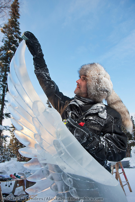 "Steve Cox, USA, works on the wing of a creature for the multi block sculpture titled ""Guardian Angel of Mischief"" for the 2009 World Ice Art Championships in Fairbanks, Alaska. Team members: Heather Brice, Kevin Gregory, Jeff Stahl, Steve Cox"