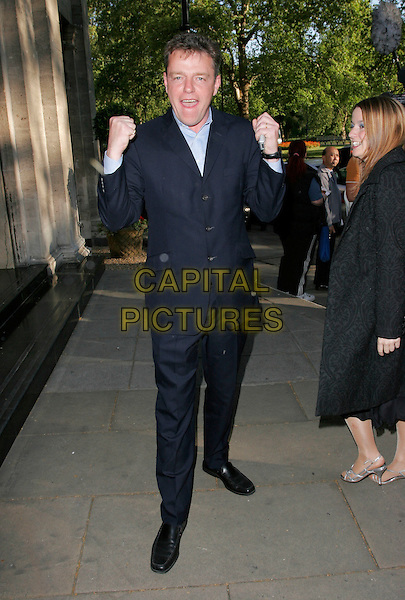 SUGGS.Attending the Sony Radio Academy Awards, Grosvenor House Hotel, London, England, April 30th 2007..full length black suit funny hands pose.CAP/AH.©Adam Houghton/Capital Pictures.